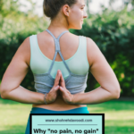 Young woman stands in back namaste yoga pose.