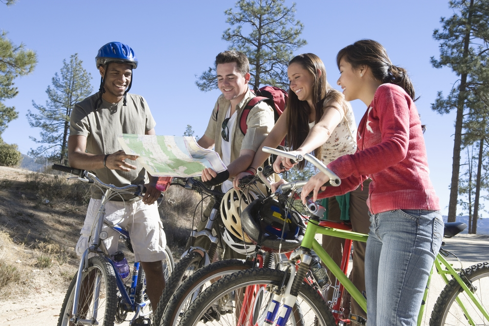 Friends biking together and looking at a map