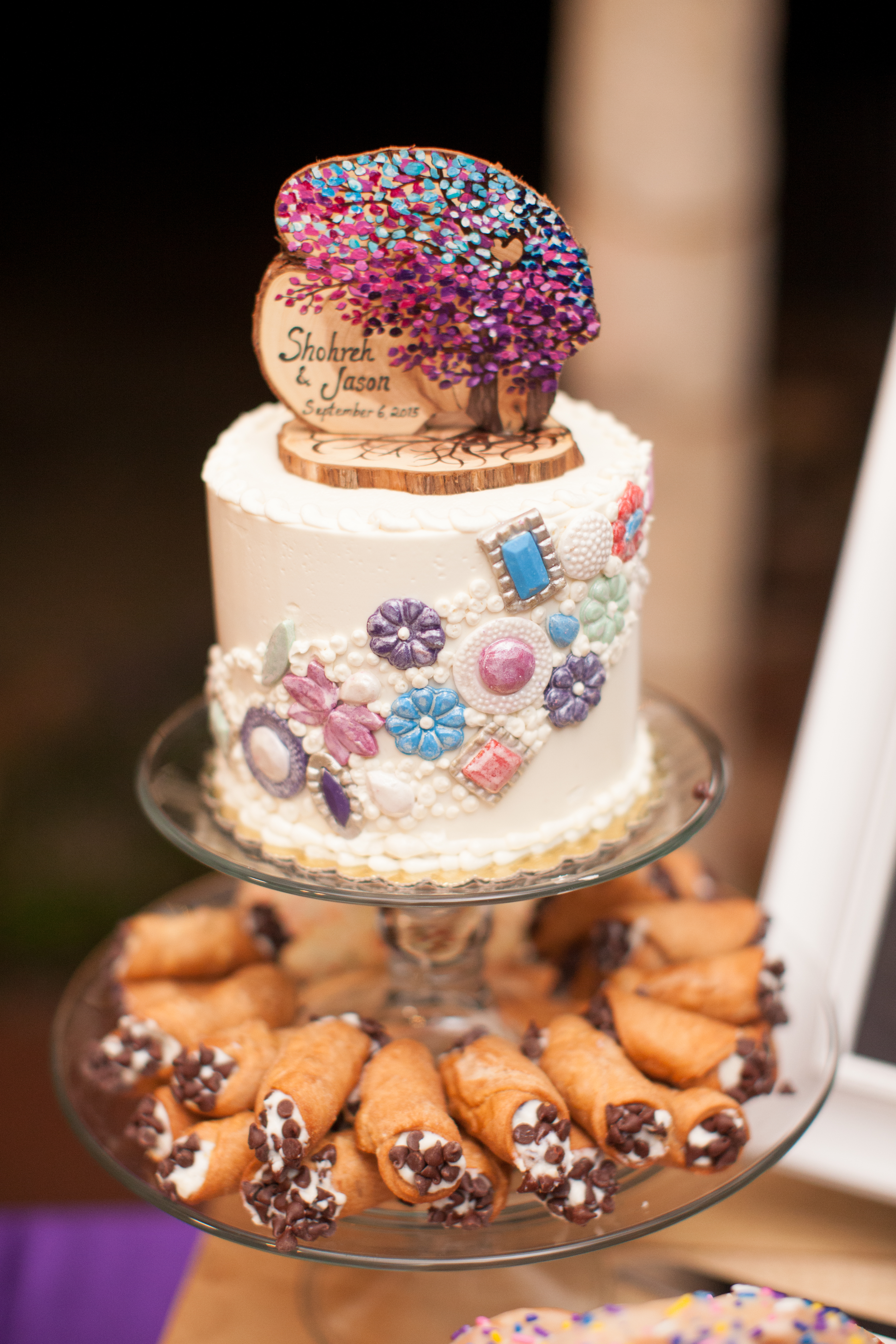 Shohreh and Jason's single-tier wedding cake with a wooden tree topper with a colorful painted tree and their names and wedding date