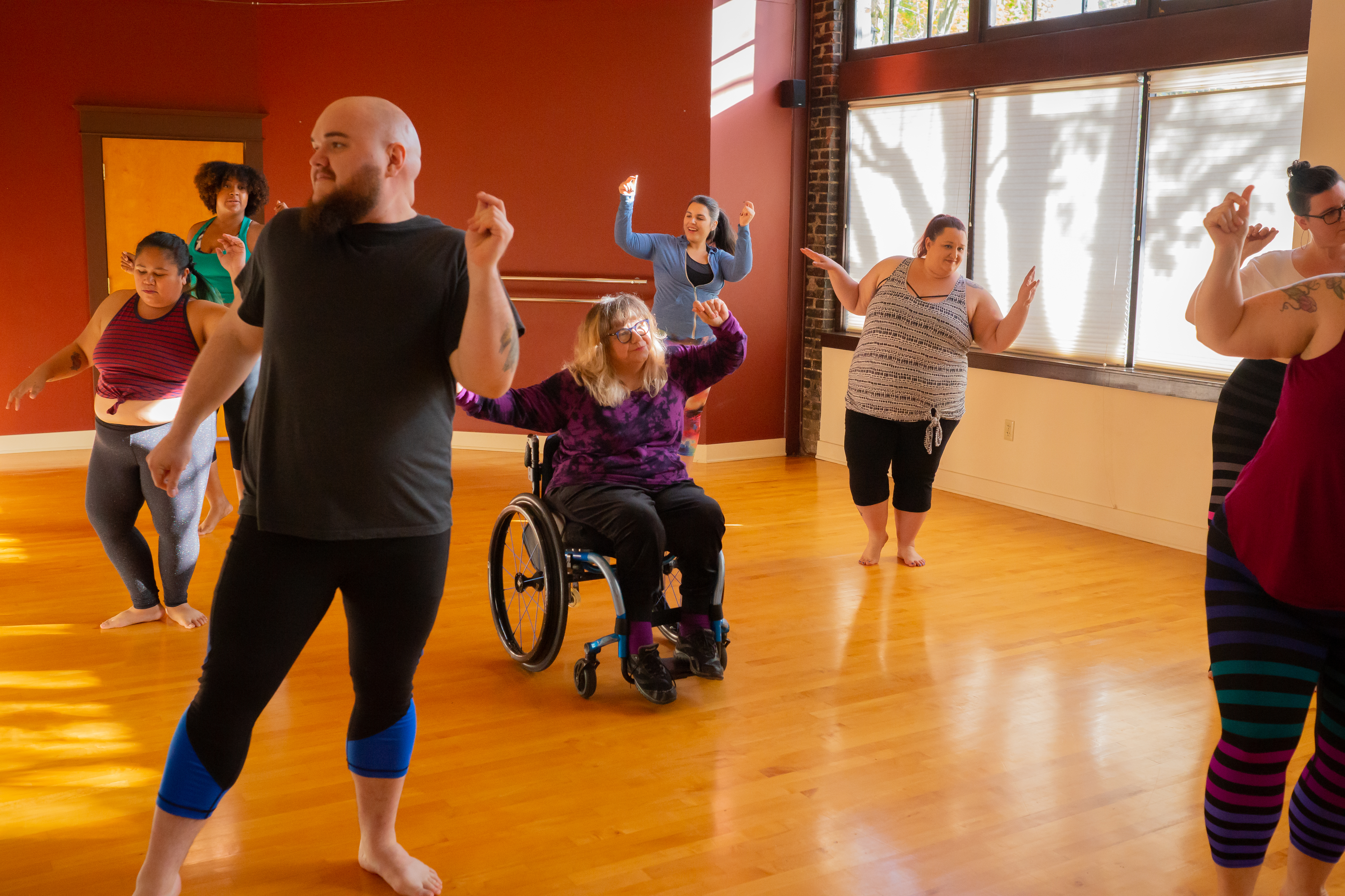 A diverse group of people dancing in an exercise studio