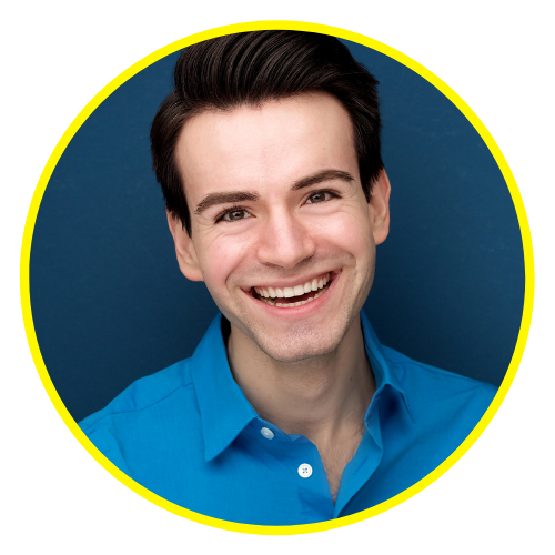 A headshot of James wearing a bright blue collared shirt and smiling big.